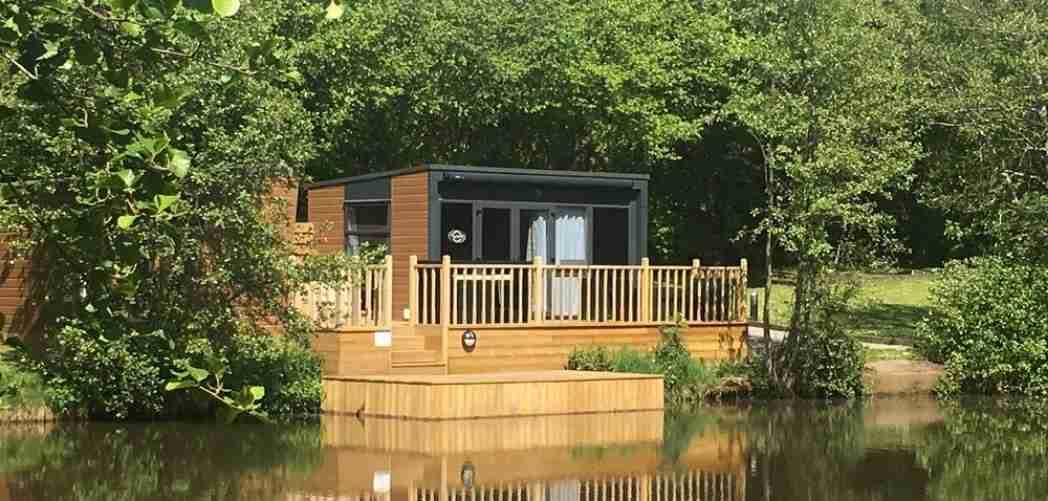 best UK carp fishing holidays lodge on a lake